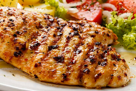 Grilled chicken breast and vegetables photo