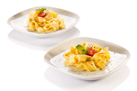 Pasta with tomatoes and white cheese photo
