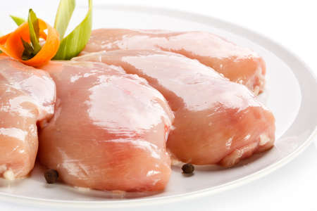 Raw chicken breasts on white  photo