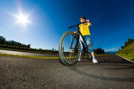 bike trail: Boy cycling Stock Photo