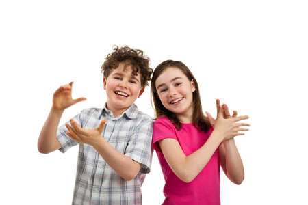 Boy and girl clapping hands