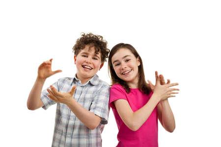 Jongen en meisje handen klappen Stockfoto