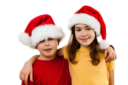 arms around: Boy and girl posing while wearing santa hats