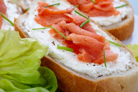 Smoked salmon with cream cheese on bread slices photo