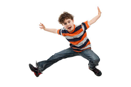 hopping: A boy jumping up in the air Stock Photo