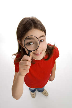 spy girl: Girl holding a magnifying glass