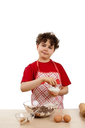 Boy baking in the kitchen photo
