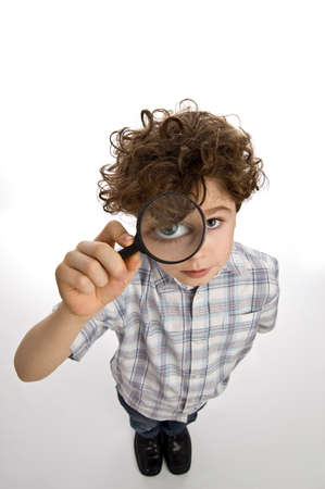 investigating: Boy holding a magnifying glass