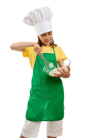 Girl mixing dough in a bowl with a whisk  photo