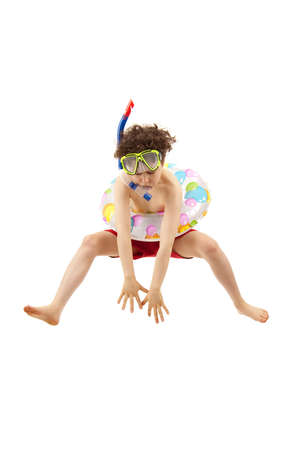 hopping: Boy wearing snorkeling equipments while jumping