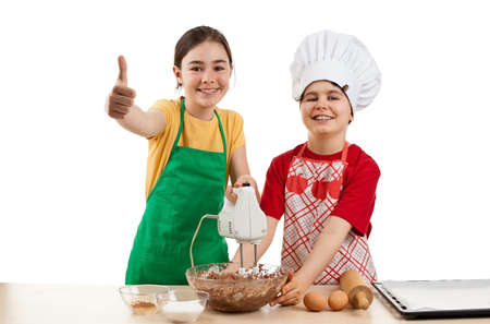 Kids baking together in the kitchen photo