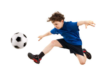 kicking ball: Boy playing football isolated on white Stock Photo