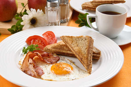 greasy: Breakfast set consisting of toasts, egg, bacon and vegetables
