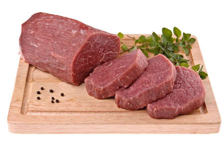 Slices and chunks of beef photo