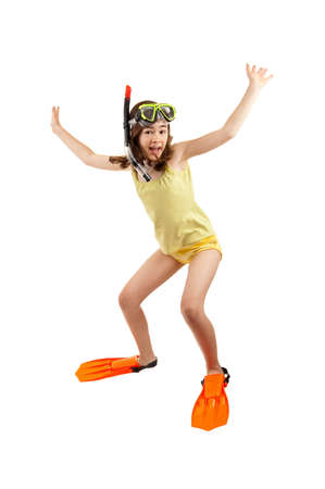 hopping: Girl wearing snorkeling equipments while jumping Stock Photo