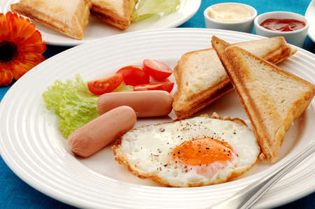 western food: Sandwiches, sausage and egg breakfast meal Stock Photo