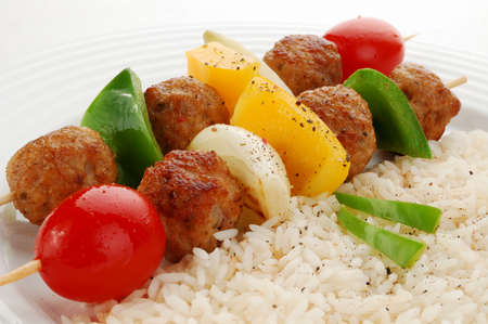 Meatballs and vegetables on a skewer photo