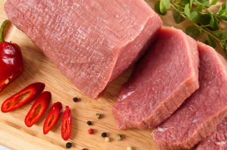 Fresh raw beef on a wooden chopping board photo