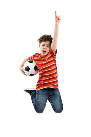 boy ball: Boy jumping while holding a football