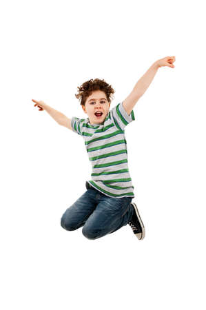 hopping: Boy jumping with his hands and legs in the air Stock Photo