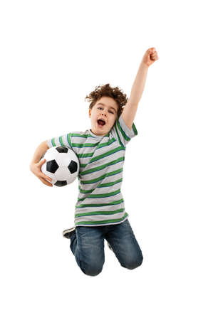 child ball: Boy jumping while holding a football
