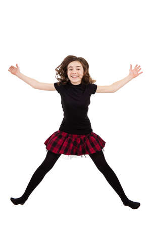 checkered skirt: Girl jumping Stock Photo