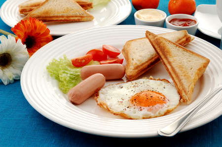 Sandwiches, sausage and egg breakfast meal photo