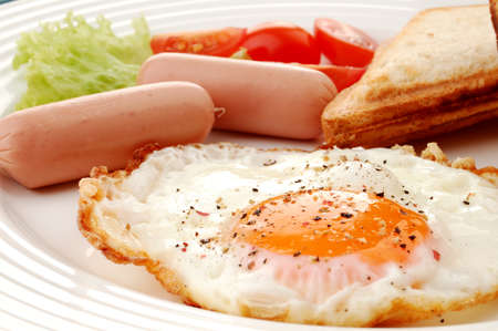 sunny side up: Sandwiches, sausage and egg breakfast meal Stock Photo