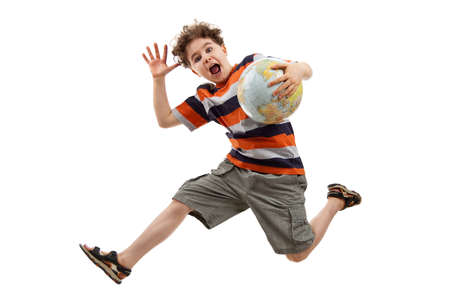 Boy in casual wear jumping and holding a globe photo