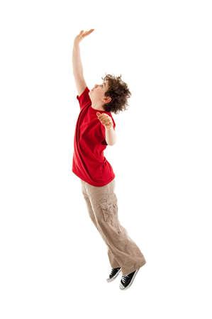 khakis: Boy jumping with arm raised Stock Photo