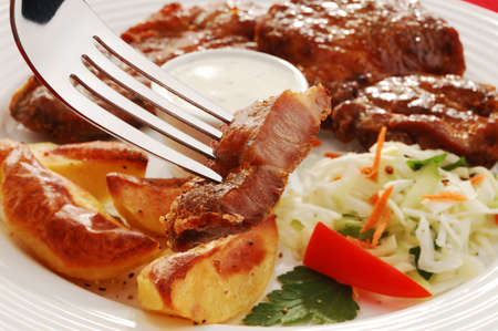 close up food: Fried steak with potatoes and salad