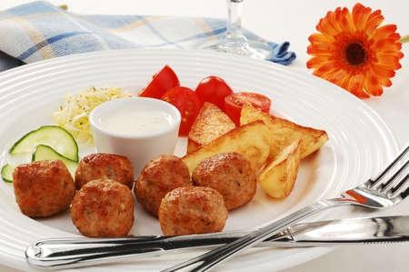 Meatballs with potatoes and salad photo