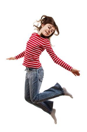 Chica casual saltando por desgaste Foto de archivo