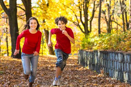 Siblings at a park photo