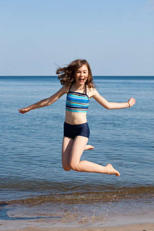 Girl jumping in beach