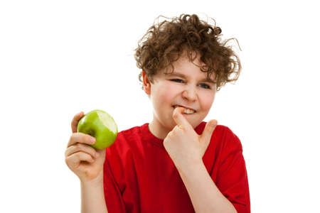 stuck: Boy eating green apple  Stock Photo