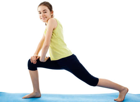 knee bend: Girl stretching on yoga mat