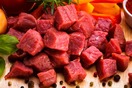 Close-up of raw beef cubes on cutting board