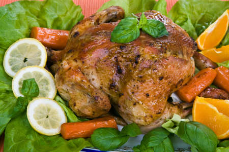 chicken grill: Roasted chicken with oranges and carrots