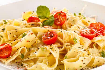 Close-up of pasta with cherry tomatoes photo