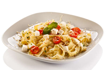 Pasta with cherry tomatoes and white cheese photo