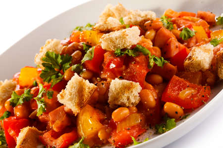Diced sausage with tomato, beans and bread crumbs photo