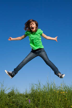 dynamic activity: Girl jumping in meadow