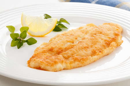 fried fish: Fish fillet with lemon slice Stock Photo