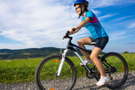 bicycle lane: Girl riding a bike