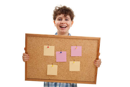 Young boy holding noticeboard isolated on white background