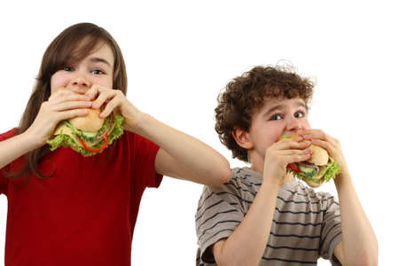 kids eating healthy: Kids eating healthy sandwiches isolated on white background Stock Photo
