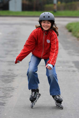 roller blade: Young girl on roller blades Stock Photo