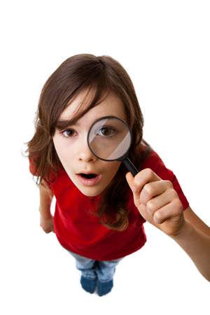 Junge Mädchen mit Lupe Lizenzfreie Bilder