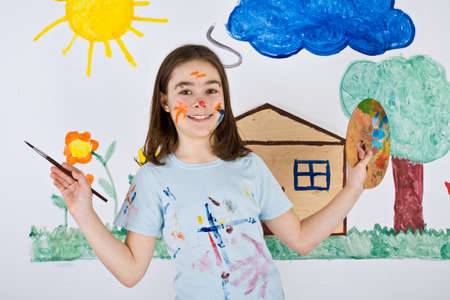 Kid painting on wall Stock Photo